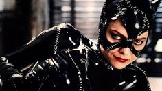 """Michelle Pfeiffer. Tim Burton's 1992 Batman Returns redefined the campy Catwoman for the '90s, moving the costume from sparkly lycra catsuit of the '60s Batman TV show to an edgier, Burton-y stitched latex suit that made Michael Keaton's Bruce Wayne especially hot under the cowl. Plus, the catty and overtly sexual Pfeiffer knew how to handle her whip, and she even recently offered to give """"whipping lessons"""" to the next Catwoman in line. Rrrowr!"""