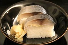 """Mackerel sushi stick (""""saba-no-bou-sushi"""").   Mackerel spoils easily, so it was immediately vinegared for preservation. In Kyoto, mackerel caught in the Sea of Japan was vinegared and pressed into a stick-shaped sushi. This method of preparing mackerel was brought to the Kyoto region around 260 years ago. The tradition has been handed down as food culture of the court nobles.  https://www.facebook.com/thesamuraigourmet.jp"""
