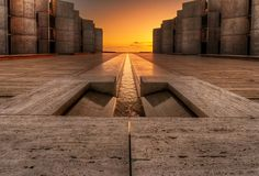 The Salk institute in San Diego has some mind blowing architecture. The institute is housed in a complex designed by the firm of Louis Kahn. Michael Duff of the Kahn firm was the supervising architect and a major design influence on the structure that consists of two symmetric buildings with a stream of water flowing in the middle of a courtyard that separates the two.