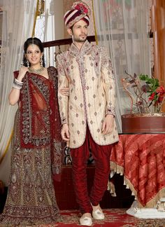 Bound to get you all the attention dressed in this Cream Brocade Sherwani. All patterns are intricately embellished with Brocade Patch, Butta Work, Crystals & Stones, Lace, Resham, Single Tone &am...