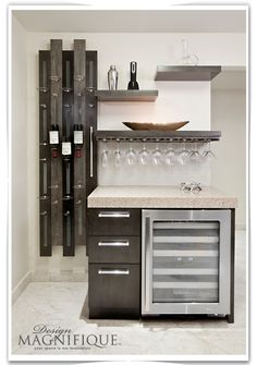 Miami Condo Design - contemporary  #InteriorDesign - #DesignMagnifique - Photographer - Norma Lopez Molina - The wine rack is actually a door put in place to hide the unsightly electrical panel box in the kitchen.