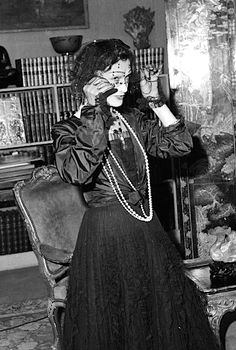 Coco Chanel, in black organza and pearls, in her apartment at rue Cambon, Paris, 1950.