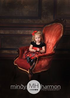 Our red chair was the perfect addition to this portrait!  We have a lot of furniture options for your session!  Call the studio to book your session 281-296-2067 or online at mindyharmon.com #mhp #mindyharmon #thewoodlandsphotographer #children #holidayportraits