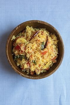 From SAVEUR Issue #167Given that rice is grown throughout southern India, it makes sense that there are so many variations on how to serve it. Flavored with sweet plum tomatoes and aromatic spices, this rice dish is perfect alongside roast chicken.