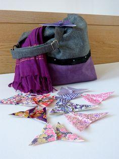 Papillons rose et violets par Estampapier. vendu 10€