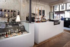 white tiles, exposed walls, timber, great display cabinets