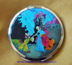 1930's Stratton 'Non Spill' compact with reverse painted celluloid over butterfly wing