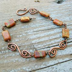 Unakite and Antiqued Copper wire wrap and stone bracelet. $18.00, via Etsy.