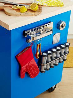 Magnets are a quick DIY organizer's best friend. They allow for flexibility and usability even in the tightest of spaces. Here, a few hooks and rails offer a great way to keep spices and utensils close at hand. Try a solution such as this in an office, too./