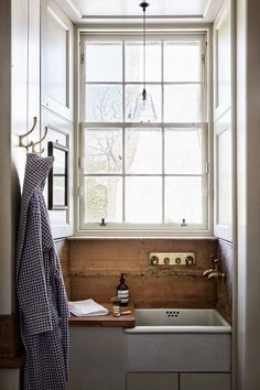 A butler sink is an unusual choice for a bathroom, but it works beautifully with. A butler sink is Minimalist Bathroom, Modern Bathroom, Bathroom Ideas, Bathroom Designs, Beautiful Bathrooms, Restroom Ideas, Bathroom Sinks, Downstairs Bathroom, Simple Bathroom