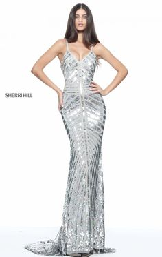 Be the queen of the night in Sherri Hill 51206. Plunging V-neckline with slim straps lead the mid open back. A mixture of beads and sequins splashed the entire outfit from the top cascading down the full length finish.