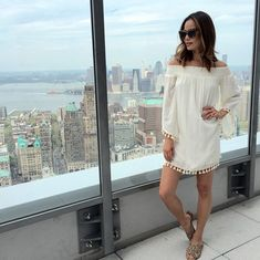 Jamie Chung in a tasseled cream mini dress and summer slides