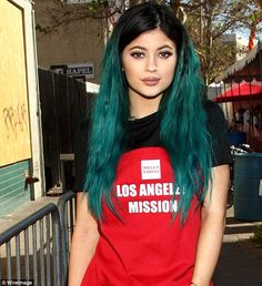 All dolled up: The teal haired starlet finished her look with her trademark plump pout...