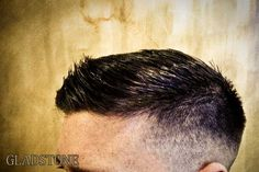 Here's another side slick Comb over cut. For this style, back & sides are shaved close and gradually tapered out to a grade 0, this is known as a 'skin fade'. The hair on top is then cut to the desired length so it can be styled as shown.