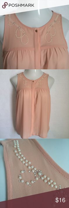NEW ListingChloe K sleeveless peach top Chloe K sleeveless peach top embellished with pearls & rhinestones on front yoke. Hidden button front with top goldtone button. ** There are a few missing pearls (I spotted 3) and maybe a rhinestone or two, but is nothing overtly noticeable**. Size is S. 100% polyester (exc. trim). Not interested in trades. Chloe K Tops