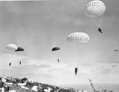 Feb. 1945: U.S. paratroopers of the 503rd Paratroop Regiment float to earth on Corregidor, a rocky island strategically located at the entrance of Manila Bay on Luzon Island, Philippines during World War II.