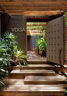 VDGA OFFICE - Picture galleryVDGA OFFICE - Picture galleryGrand Designs explores homes with great ambitions in a small spaceThe double-height entrance hall creates a breathtaking view when the light hits the wooden slats on the Office Entrance, Entrance Design, Entrance Gates, House Entrance, Door Design, Modern Entrance, Entrance Ideas, Front Office, Main Entrance