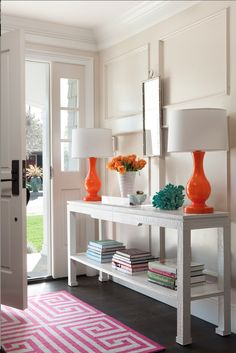 creating an entryway- something like this. Long/narrow table with shelf beneath, lamp & place for keys & vase- maybe Mirror above