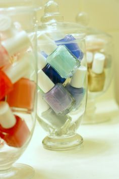 organize nail polish in apothecary jars...or duh...any large transparent glass / container... seeallthecolors and store