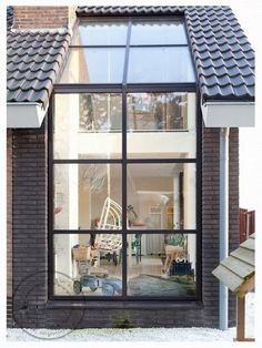 ... in the Netherlands ... have a look to the huge window/patio, the natural wood floor... great space and so many light inside!!!! u...