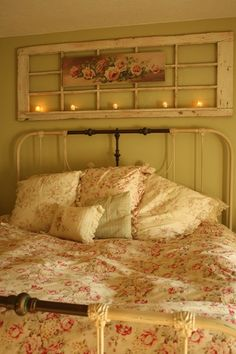 Cottage style glass paned door being used above the bed as a beautiful display.