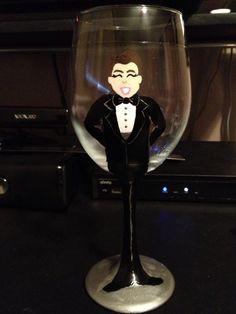 Painted wine glass by Angela. $25 each.I do custom orders as well.