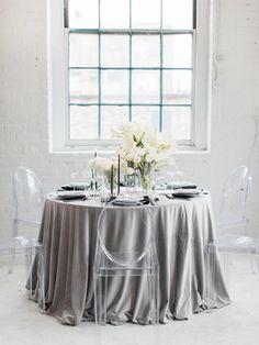 Gray linens and modern ghost chairs: http://www.stylemepretty.com/2016/12/14/masculine-elegance-wedding-ideas/ Photography: Samantha James - http://www.samanthajamesphoto.com/