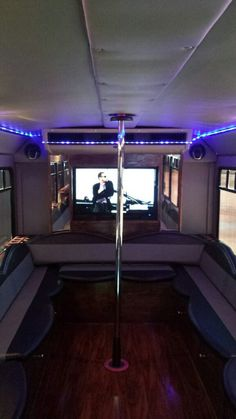 20 Passenger Party Bus with disco lights, dance pole, hardwood floors, wrap around seating, flat screens for videos & surround sound with bluetooth and auxiliary to play your own music! Hummer Limo, Stripper Poles, Hardwood Floors, Flooring, Disco Lights, Party Bus, Busses, Surround Sound, Pole Dancing