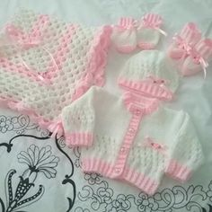 Lovely baby layette sets, hand knitted in super soft acrylic baby yarn in beautiful pastel colours available to order www.gemknits4kids.com #gemknits4kids-#babygifts #etsycraft #hand made #babies #etsycraft #blanket #newborn #reborn #knitted #cardigan #babygifts