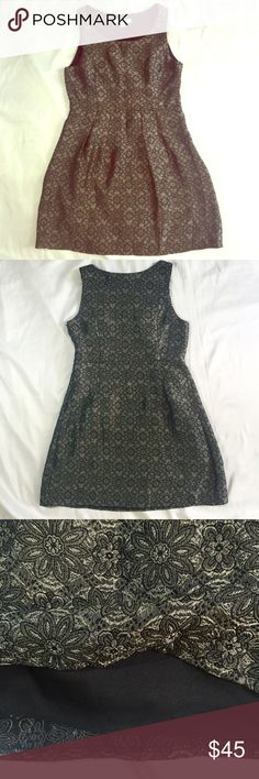 """Silver Floral Metallic Party Dress Homecoming EUC! Silver and black floral party dress from YA Los Angeles. Perfect for a cocktail party, homecoming dance, or other semi-formal event! Fully lined. Cotton and polyester fabric. Approx measurements: 33.5"""" length, 15.5"""" waist, 18"""" chest. No holes or stains. 🚫trades🚫 smoke free home Ya Los Angeles Dresses Mini"""