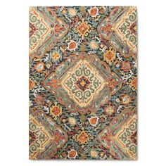 Add interest to your space with the Area Rug Valencia 5'X7' - Threshold™. This on-trend rug has an artistic diamond design in shades of rust, green and cream. These rugs are hand tufted in wool material and can be spot cleaned as needed. 7'Lx5'W