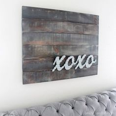 Make wood look weathered and add galvanized metal letters to make industrial-inspired art for any bedroom.