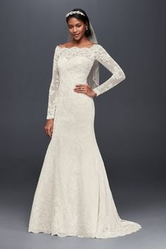 The scalloped lace that trims this off-the-shoulder mermaid dress lends a romantic feel that complements its alluring, form-fitting lines. A lacy illusion back creates even more drama.   Jewel, a David's Bridal exclusive  Petite  Polyester  Sweep train  Button back; fully lined  Dry clean  Imported  Also available in regular and extra length