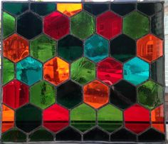 A beautiful and carefully crafted stained glass panel in hexagonal design. All parts have been copper foiled and leaded. Please get in contact to purchase your own version of this panel or other design, we can make to most sizes and can choose colours that reflect your personal style or the decor of your home. We can also make this into a hanging panel by soldering hooks with chains to the body of the design.