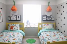 Ok, Cool. Now I'm Jealous Of These Toddlers (Seriously, Their Room is So Cool).A rad room for brothers, the decal-adorned wall will look cool even when these toddlers are teenagers, and I can vouch for the awesomeness of this IKEA bedding, as my 10-year-old has the same set.