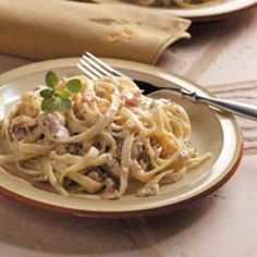 "Fettuccine with Bacon-Clam Sauce Recipe -Clams, garlic, bacon and Parmesan cheese flavor this hearty pasta dish from Darlene Hicks. ""It's been a favorite for years,"" she writes from her home in Arcata, California. ""A side salad and garlic bread complete the meal."""
