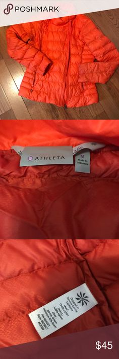 Amazing Athleta goose down light puffer Bright orange with asymmetrical zip. No hood.  Some discoloring at sleeves. Not very noticeable and price adjusted and firm for this beauty. Athleta quality piece Athleta Jackets & Coats Puffers