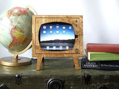what a fun idea. Look at this vintage inspired ipad dock made to look like a retro tv set!