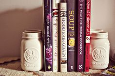 This is a great way to make DIY bookends: painted mason jars weighed down with sand, rice, etc!