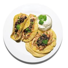 Make a superfast, spicy adobo sauce to flavor these chicken tacos. Using the leftover roast chicken from Monday's feast gives you time to sip a cerveza while the sauce is simmering.