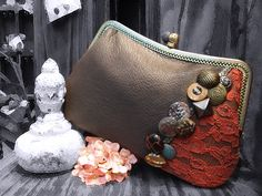 Vintage buttons. Genuine leather. Lace overlay. Felt lining. Snap closure. 100% handcrafted. $170.
