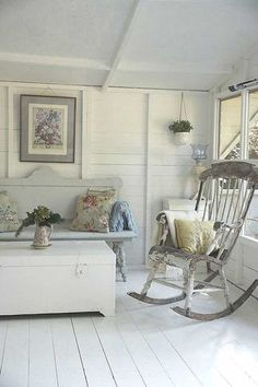 Fabulous rustic rocking chair and bench in cottage sunroom.