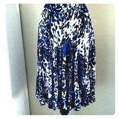 Gorgeous Mediterranean Blue, White & Black Skirt Gorgeous Mediterranean Blue, White & Black Graphic Print Skirt. 25 inches long with and elastic waist and flowing A-line skirt make this a Day to Evening Summertime Staple indeed! Size Petite Small Skirts