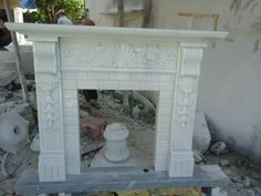 fireplace/mantel in white marble.  Pls contact danang.marble@gmail.com or danangmarble.com.vn for order or more information.