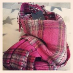 Gant scarf in Rasberry color. My favorite for this winter. So warm... it matches most of my clothes!