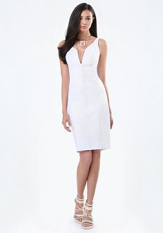 Provocative jersey dress detailed by slimming seaming and a sizzling plunge neck. Bodycon design gets attention. Reinforced plunge neck for secure fit. Back hook-and-eye and exposed zip closure. Fully lined.