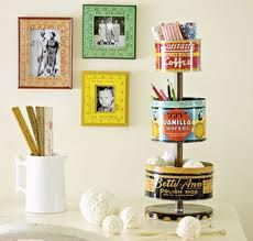 large tin canisters (bulk size) can be reused for a cool 3-tier organization idea