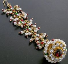 Rakhdi RAJASTHANI JEWELLERY ( This is a bell-like accessory which the bride wears on her forehead. It is a headgear which the Marwari brides call it as maang tikka. )