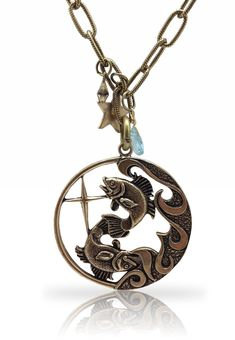"""Ts Accessories  Pisces Zodiac Necklace  Amazing detailing enhances this bronze-tone Pisces circular pendant necklace. The large pendant is attached to a sturdy link chain. This is a beautiful piece of fun vintage jewelry.     Bronze finish  Chain length:36""""   #EMBELLISHME #fashion Get yours at www.TsAccessories2You.com."""
