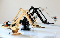 UFactory is raising funds for uArm: Put a Miniature Industrial Robot Arm on Your Desk on Kickstarter! uArm is an Arduino-powered desktop parallel-mechanism robot arm, modeled after the ABB industrial PalletPack robot. Diy Electronics, Electronics Projects, Drones, Arduino Programming, Industrial Robots, Industrial Engineering, Super Cool Stuff, Arduino Projects, Pi Projects